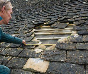 A Man Repairing Roof