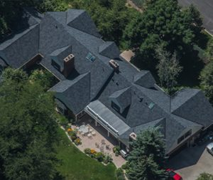 Areial View of a Gray Roof Residential House